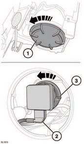 1. At the back of the headlamp unit, remove